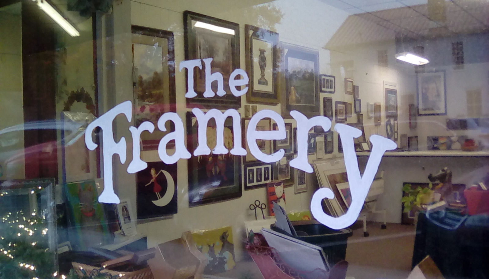 The Framery logo on store window